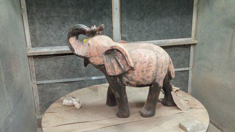 Ebony_Elephant_refinished_before_and_after_1