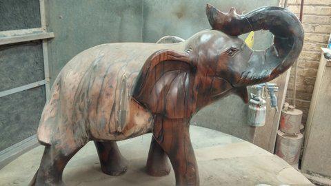 Ebony_Elephant_refinished_before_and_after_2
